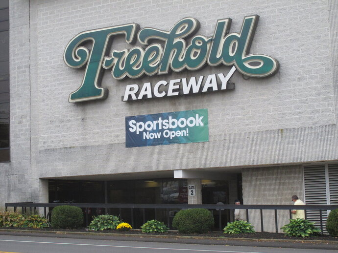 This Oct. 24, 2020 photo shows the exterior of the Freehold Raceway track in Freehold, N.J. Freehold has become the third New Jersey horse track to offer sports betting, and it joins eight Atlantic City casinos in doing so. (AP Photo/Wayne Parry)