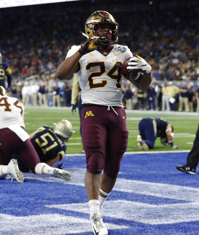 Minnesota running back Mohamed Ibrahim celebrates a 3-yard touchdown against Georgia Tech during the second half of the Quick Lane Bowl NCAA college football game, Wednesday, Dec. 26, 2018, in Detroit. (AP Photo/Carlos Osorio)