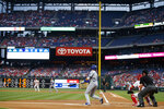 Los Angeles Dodgers' A.J. Pollock follows through after hitting an RBI sacrifice fly off Philadelphia Phillies starting pitcher Nick Pivetta during the first inning of a baseball game, Wednesday, July 17, 2019, in Philadelphia. (AP Photo/Matt Slocum)