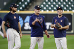 Houston Astros starting pitcher Gerrit Cole, left, manager AJ Hinch, center, and third baseman Alex Bregman, right, talk during a practice for a baseball American League Championship Series in Houston, Friday, Oct. 11, 2019. Houston will face the New York Yankees, Saturday. (AP Photo/Eric Gay)