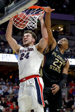 FILE - In this March 28, 2019, file photo, Gonzaga forward Corey Kispert, left, dunks past Florida State guard M.J. Walker during an NCAA men's college basketball tournament West Region semifinal, in Anaheim, Calif. (AP Photo/Marcio Jose Sanchez, File)