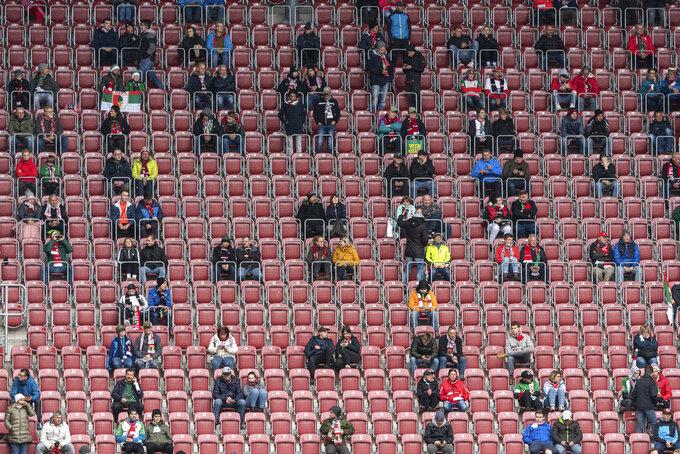 Fans sit on the tribune prior the German Bundesliga soccer match between FC Augsburg and Borussia Dortmund in Augsburg, Germany, Saturday, Sept. 26, 2020. (Matthias Balk/dpa via AP)