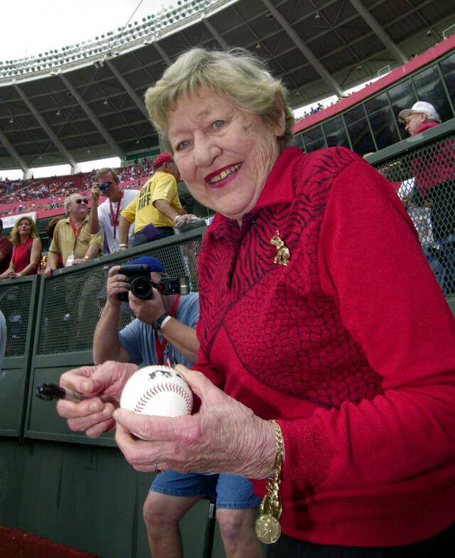 FILE - In this Sept. 22, 2002 file photo former Cincinnati Reds majority owner Marge Schott signs autographs prior to the final game at Cinergy Field in Cincinnati. Schott was a divisive figure when she owned the Cincinnati Reds, getting suspended and ultimately forced out for her racially offensive language.  The community is debating what to do with facilities named in her memory. (AP Photo/David Kohl, file)