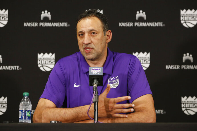 FILE - In this April 11, 2019, file photo, Sacramento Kings general manager Vlade Divac answers questions concerning the decision to fire coach Dave Joerger in Sacramento, Calif. Divac has stepped down as general manager of the Kings and will be replaced on an interim basis by Joe Dumars. The Kings announced the move Friday, Aug. 14, 2020, a day after they ended their 14th straight season without a playoff berth. (AP Photo/Rich Pedroncelli, File)