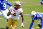 Boston College wide receiver Zay Flowers (4) runs past Duke Blue Devils cornerback Mark Gilbert (28) after a catch during the first half of an NCAA college football game, Saturday, Sept. 19, 2020, in Durham, N.C. (Nell Redmond/Pool Photo via AP)
