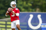 Indianapolis Colts quarterback Brett Hundley throws during practice at the NFL team's football training camp in Westfield, Ind., Saturday, July 31, 2021. (AP Photo/Michael Conroy)
