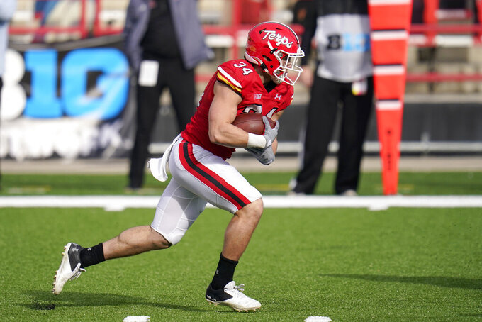 Maryland running back Jake Funk runs with the ball against Rutgers during the first half of an NCAA college football game, Saturday, Dec. 12, 2020, in College Park, Md. (AP Photo/Julio Cortez)