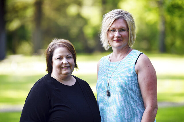 This July 31, 2019 photo shows Stillwater Christian School parents Jeri Anderson and Kendra Espinoza at Woodland Park in Kalispell, Mont.  The Supreme Court will hear arguments Wednesday, Jan. 22, 2020 in a dispute over a Montana scholarship program for private K-12 education that also makes donors eligible for up to $150 in state tax credits. Advocates on both sides say the outcome could be momentous because it could lead to efforts in other states to funnel taxpayer money to religious schools. (Casey Kreider/The Daily Inter Lake via AP)