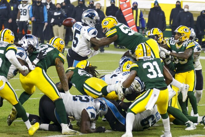 Green Bay Packers' Krys Barnes knocks the ball away from Carolina Panthers' Teddy Bridgewater at the goal line during the first half of an NFL football game Saturday, Dec. 19, 2020, in Green Bay, Wis. The Packers recovered the fumble. (AP Photo/Matt Ludtke)