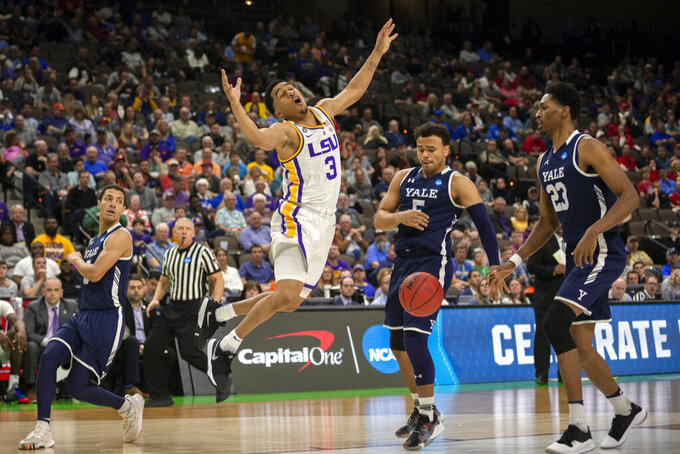 LSU guard Tremont Waters (3) reacts after rebounding the ball while being defended by Yale guard Alex Copeland (3) during the second half of the first round men's college basketball game in the NCAA Tournament in Jacksonville, Fla. Thursday, March 21, 2019. (AP Photo/Stephen B. Morton)