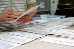 FILE - In this May 28, 2020, file photo processing work on mail in ballots for the Pennsylvania Primary election is being done at the Butler County Bureau of Elections, in Butler, Pa. With concerns rising in Pennsylvania that tens of thousands of mail-in ballots will be discarded in the presidential election over technicalities, officials in the battleground state told counties that they aren't allowed to reject a ballot solely because an election official believes a signature doesn't match the signature in the voter's file.  (AP Photo/Keith Srakocic, File)