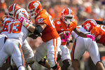 Clemson running back Travis Etienne (9) runs the ball in for a 25 yard touchdown during an NCAA college football game against Syracuse in Clemson, S.C., on Saturday, Oct. 24, 2020. (Ken Ruinard/Pool Photo via AP)