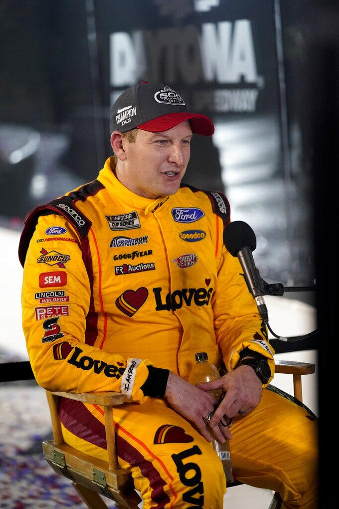 Michael McDowell is interviewed after winning the NASCAR Daytona 500 auto race at Daytona International Speedway, Monday, Feb. 15, 2021, in Daytona Beach, Fla. (AP Photo/John Raoux)