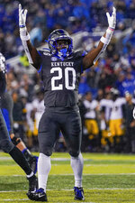 Kentucky running back Kavosiey Smoke (20) celebrates his touchdown during the first half of NCAA college football game against Missouri, Saturday, Oct. 26, 2019, in Lexington, Ky. (AP Photo/Bryan Woolston)