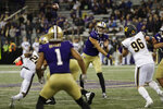 Washington quarterback Jacob Eason, center, passes to tight end Hunter Bryant (1) during the first half of an NCAA college football game against California, Saturday, Sept. 7, 2019, in Seattle. (AP Photo/Ted S. Warren)