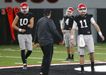 Georgia quarterbacks Jacob Eason (10) and Jake Fromm (11) take part during the team's practice Saturday, Jan. 6, 2018, in Athens, Ga., for Monday's NCAA championship football game against Alabama in Atlanta. (Joshua L. Jones/Athens Banner-Herald)