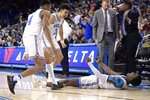 UCLA guard Kris Wilkes, right, celebrates after scoring and drawing a foul, next to Jaylen Hands, left, and Jules Bernard during the second half of an NCAA college basketball game against Oregon on Saturday, Feb. 23, 2019, in Los Angeles. UCLA won 90-83. (AP Photo/Mark J. Terrill)