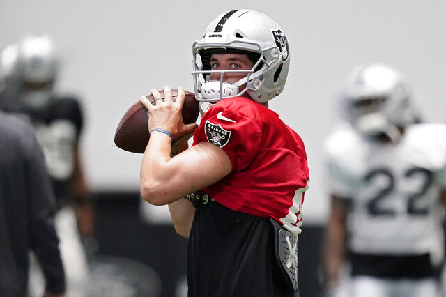 FILE - Las Vegas Raiders quarterback Derek Carr (4) prepares to throw a pass during an NFL football training camp practice Tuesday, Aug. 18, 2020, in Henderson, Nev. The Raiders play the Carolina Panthers on Sunday, Sept. 13.(AP Photo/John Locher, Pool, File