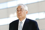 Former Tokyo Electric Power Co. (TEPCO) Vice President Sakae Muto arrives at Tokyo District Court in Tokyo Thursday, Sept. 19, 2019. The court said three former TEPCO executives, Tsunehisa Katsumata, Muto and Ichiro Takekuro, are not guilty of professional negligence in the 2011 Fukushima meltdowns. Thursday's ruling marked the end of the only criminal trial in the nuclear disaster that has kept tens of thousands of residents away from their homes because of lingering radiation contamination. (Satoru Yonemaru/Kyodo News via AP)