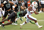 Syracuse running back Sean Tucker (34) evades Ohio defenders during an NCAA college football game, Saturday, Sept. 4, 2021, in Syracuse, N.Y. (N. Scott Trimble/The Post-Standard via AP)