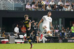 Inter Miami defender Leandro Gonzalez Pirez, right, heads the ball next to Columbus Crew midfielder Liam Fraser (18) during the second half of an MLS soccer match Saturday, Sept. 11, 2021, in Fort Lauderdale, Fla. Inter Miami won 1-0. (AP Photo/Lynne Sladky)