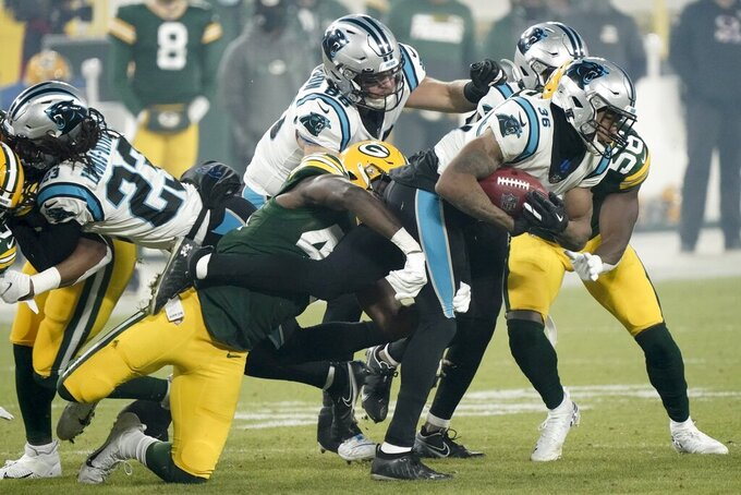 Carolina Panthers' Trenton Cannon runs during the first half of an NFL football game against the Green Bay Packers Saturday, Dec. 19, 2020, in Green Bay, Wis. (AP Photo/Morry Gash)