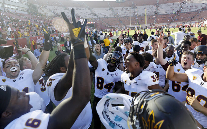 Arizona State players celebrate after a 38-35 win over Southern California during an NCAA college football game Saturday, Oct. 27, 2018, in Los Angeles. (AP Photo/Marcio Jose Sanchez)
