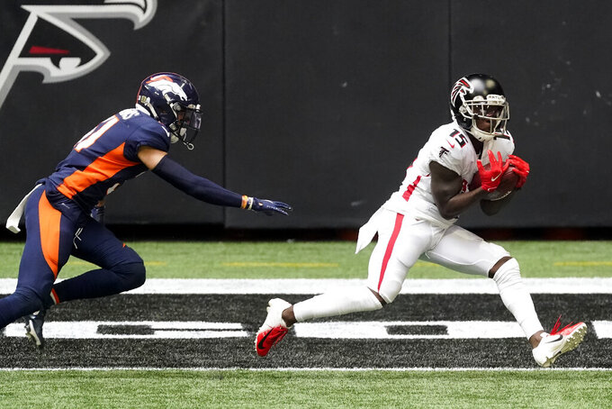 Atlanta Falcons wide receiver Brandon Powell (15) makes a touchdown catch against the Denver Broncos during the first half of an NFL football game, Sunday, Nov. 8, 2020, in Atlanta. (AP Photo/John Bazemore)