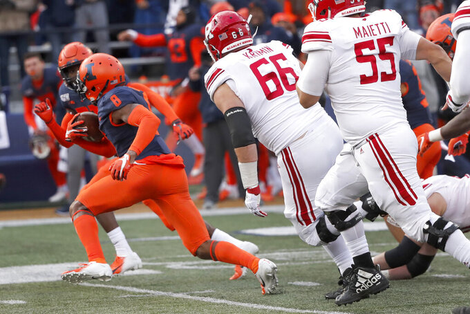 Illinois defensive back Nate Hobbs (8) returns a Rutgers fumble for a touchdown during the second half of an NCAA college football game Saturday, Nov. 2, 2019, in Champaign, Ill. (AP Photo/Charles Rex Arbogast)