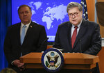 Attorney General William Barr speaks, as Secretary of State Mike Pompeo looks on, left, during a joint briefing, Thursday, June 11, 2020 at the State Department in Washington, on an executive order signed by President Donald Trump aimed at the International Criminal Court. Trump has lobbed a broadside attack against the International Criminal Court. He's authorizing economic sanctions and travel restrictions against court workers directly involved in investigating American troops and intelligence officials for possible war crimes in Afghanistan without U.S. consent. The executive order Trump signed on Thursday marks his administration's latest attack against international organizations, treaties and agreements that do not hew to its policies.  (Yuri Gripas/Pool via AP)