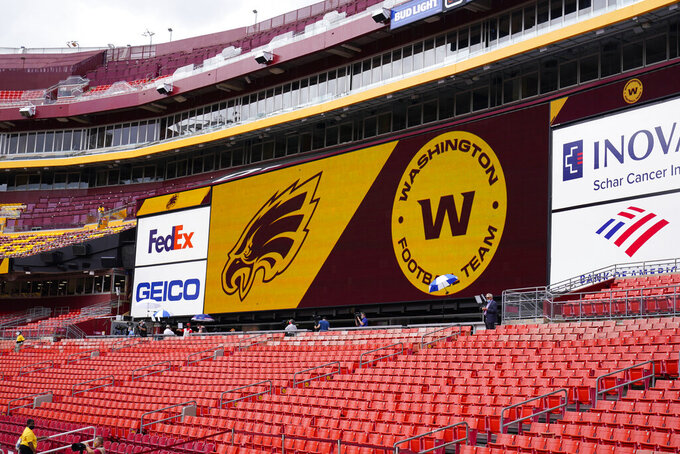 Fedex Field screen displays the Washington Football Team logo during pregame warmups before the start of a NFL football game between Washington Football Team and Philadelphia Eagles, Sunday, Sept. 13, 2020, in Landover, Md. (AP Photo/Susan Walsh)