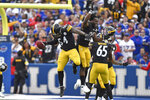 Pittsburgh Steelers linebacker Ulysees Gilbert (54) celebrates with running back Najee Harris (22) after returning a blocked punt for a touchdown during the second half of an NFL football game against the Buffalo Bills in Orchard Park, N.Y., Sunday, Sept. 12, 2021. (AP Photo/Adrian Kraus)