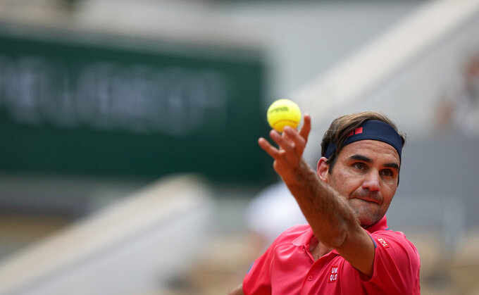 Switzerland's Roger Federer serves to Croatia's Marin Cilic for their second round match on day 5, of the French Open tennis tournament at Roland Garros in Paris, France, Thursday, June 3, 2021. (AP Photo/Michel Euler)