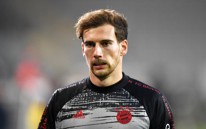 FILE - In this Oct. 17, 2020 file photo, Bayern's Leon Goretzka walks on the pitch prior the German Bundesliga soccer match between Arminia Bielefeld and Bayern Munich in Bielefeld, Germany. Germany midfielder Leon Goretzka evidently doesn't believe the old adage that sport and politics don't mix. The 25-year-old Goretzka has gained a reputation as an ethical campaigner for taking a stand against racism and anti-Semitism and for urging action on a number of other issues. (AP Photo/Martin Meissner/File)