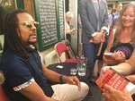 FILE - In this June 20, 2017, file photo, novelist Colson Whitehead speaks to fans after discussing his Pulitzer prize-winning book