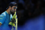 Italy's Matteo Berrettini reacts after dropping a game against Switzerland's Roger Federer during their ATP World Tour Finals singles tennis match at the O2 Arena in London, Tuesday, Nov. 12, 2019. (AP Photo/Alastair Grant)