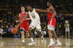 VCU Guard KeShawn Curry (11) dribbles past two St, Francis defenders during the first half of an NCAA college basketball game in Richmond, Va., Tuesday, Nov. 5, 2019. (AP Photo/Zack Wajsgras)