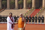 Indian Prime Minister Narender Modi, right, shakes hand with his Sri Lankan counterpart Mahinda Rajapaksa, during a ceremonial reception for Rajapaksa at the Indian presidential palace, in New Delhi, India, Saturday, Feb. 8, 2020. Rajapaksa is on a four day state visit to India. (AP Photo/Manish Swarup)