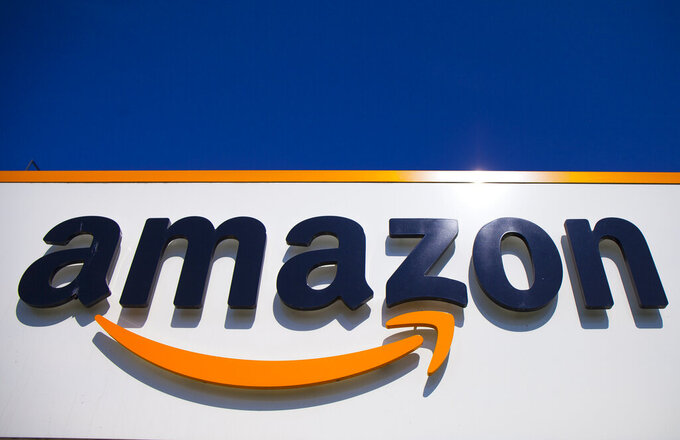 FILE - In this April 16, 2020, file photo, the Amazon logo is displayed in Douai, northern France. Amazon's pandemic boom isn't showing signs of slowing down. The company said Thursday, April 29, 2021, that its first-quarter profit more than tripled from a year ago, fueled by the growth of online shopping. It also posted revenue of more than $100 billion, the second quarter in row that the company has passed that milestone. (AP Photo/Michel Spingler, File)