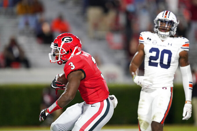 Georgia running back Zamir White (3) scores a touchdown during the first half of the team's NCAA college football game against Auburn, Saturday, Oct. 3, 2020, in Athens, Ga. (AP Photo/Brynn Anderson)