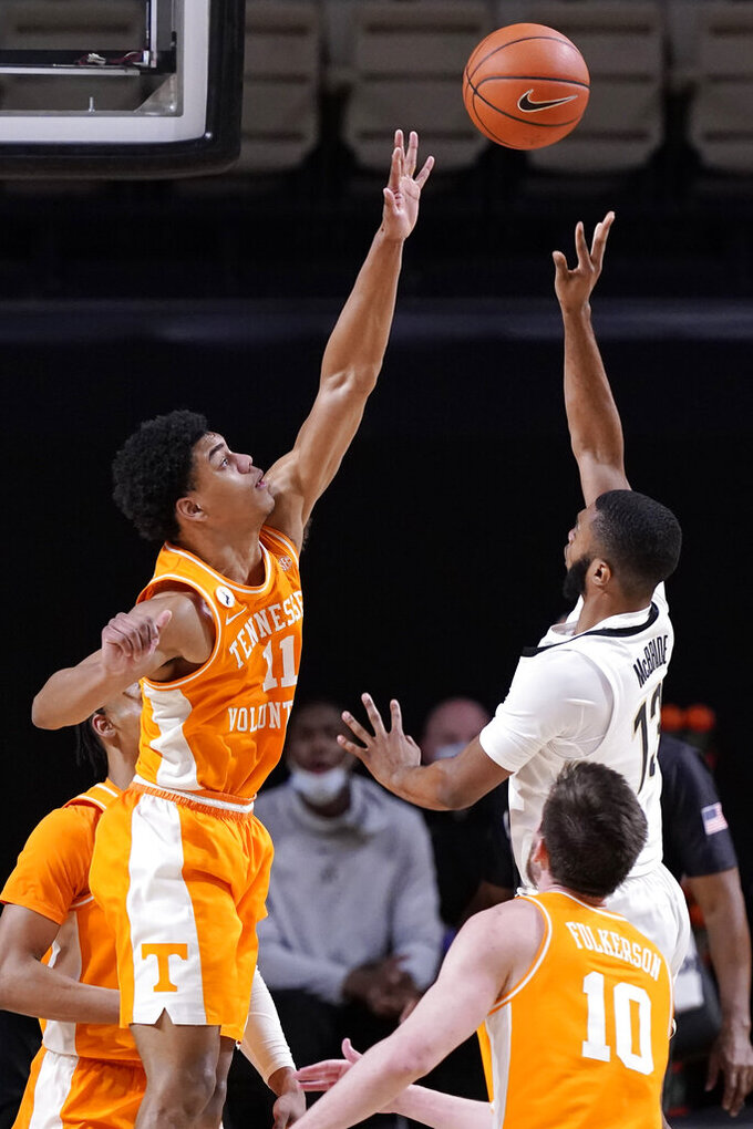 Vanderbilt's Issac McBride (13) shoots over the reach of Tennessee's Jaden Springer (11) in the second half of an NCAA college basketball game Wednesday, Feb. 24, 2021, in Nashville, Tenn. (AP Photo/Mark Humphrey)
