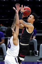 Nebraska guard Trey McGowens, right, shoots against Northwestern guard Boo Buie during the first half of an NCAA college basketball game in Evanston, Ill., Sunday, March 7, 2021. (AP Photo/Nam Y. Huh)