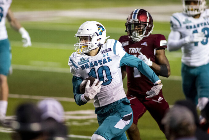 Coastal Carolina defensive back Alex Spillum (10) runs back an interception against Troy during the second half of an NCAA college football game, Saturday, Dec. 12, 2020, in Troy, Ala. (AP Photo/Vasha Hunt)