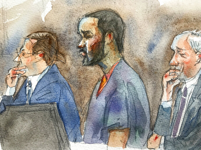 In this courtroom sketch, R&B singer R. Kelly, center, listens in federal court with his attorneys Doug Anton, left, and Steve Greenberg during his arraignment, Friday, Aug. 2, 2019 in New York. Kelly pleaded not guilty to federal charges he sexually abused women and girls. The 52-year-old Kelly was denied bail in a Brooklyn courtroom packed with his supporters. (Aggie Kenny via AP)