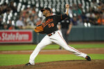 Baltimore Orioles relief pitcher Fernando Abad throws a pitch to the Toronto Blue Jays during the sixth inning of a baseball game, Friday, Sept. 10, 2021, in Baltimore. (AP Photo/Julio Cortez)