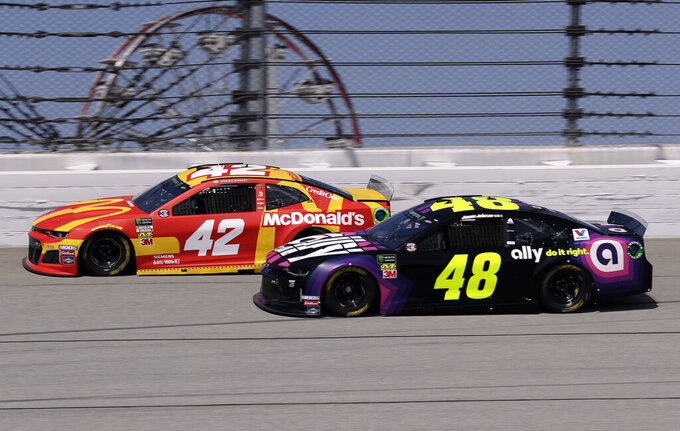 Kyle Larson, left, and Jimmie Johnson drive during a practice for the NASCAR Sprint Cup Series auto race at Chicagoland Speedway in Joliet, Ill., Saturday, June 29, 2018. (AP Photo/Nam Y. Huh)