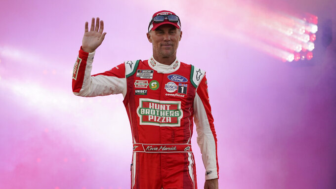 Kevin Harvick waves to the crowd during driver introductions prior to the start of the NASCAR Cup series auto race in Richmond, Va., Saturday, Sept. 11, 2021. (AP Photo/Steve Helber)
