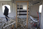 Palestinian men inspect the damage in one of the two apartments belonging to the father of Arafat Erfayieh, that was demolished by Israeli forces in the West Bank city of Hebron, Friday, April 19, 2019. The Israeli military has demolished the family home of Erfayieh,a Palestinian charged with the killing of a 19-year-old Israeli woman. (AP Photo/Nasser Nasser)