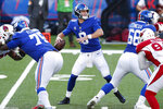 New York Giants quarterback Daniel Jones, center, throws during the first half of an NFL football game against the Arizona Cardinals, Sunday, Dec. 13, 2020, in East Rutherford, N.J. (AP Photo/Noah K. Murray)