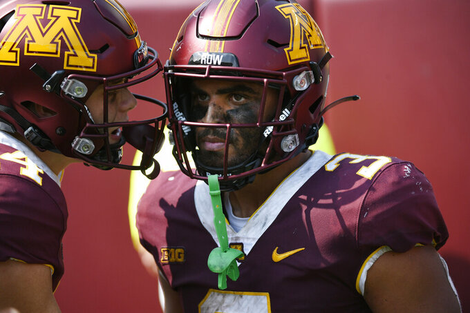 Minnesota running back Trey Potts, right, and wide receiver Brady Boyd react after Potts scored on a 21-yard touchdown run against Miami-Ohio during the second half of an NCAA college football game on Saturday, Sept. 11, 2021, in Minneapolis. (AP Photo/Craig Lassig)